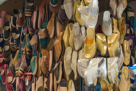 made in morocco: The colorful traditional shoes of Morocco made from leather sell in the Medina in Fes, Morocco. For gold and silver shoes made from cloth are bride shoes for wedding.