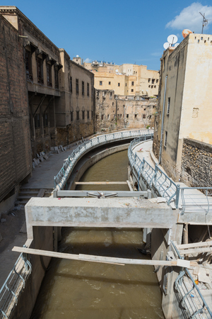 remediation: The under construction walkway along the canal through the medina in Fes, Morocco Stock Photo