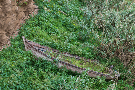 strand: One wreck wooden boat strand in the bush at Kasbah of the Udayas in Rabat, Morocco