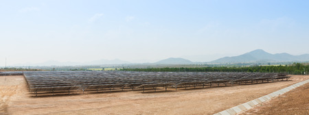 energy picture: The solar farm for green energy in the field in Thailand as panorama picture