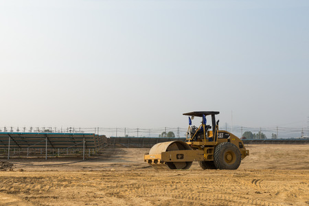 compactor: Petchaburi, Thailand - February 20, 2016: One worker drive soil compactor in the under construction solar farm on February 20, 2016 in Petchaburi, Thailand