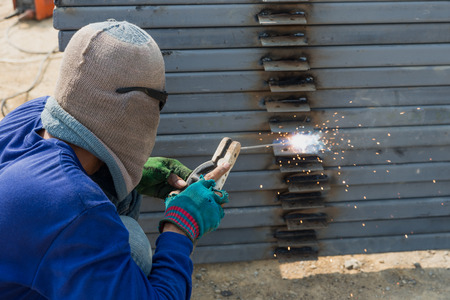 welds: The welder without personal safety protection welds metal Stock Photo