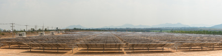 energy picture: The solar farm for green energy in the field in Thailand as panorama picture with selective focus