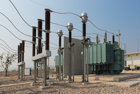 The power transformer and high voltage equipment in the outdoor electrical substation yard