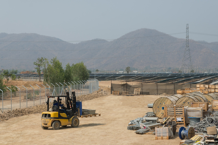 fork lift: The fork lift carry things to keep in the outdoor warehouse of solar farm