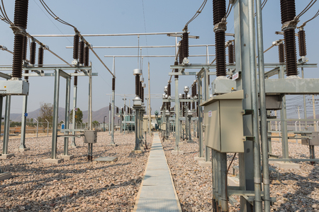 The walkway and high voltage equipment in the outdoor electrical substation yard