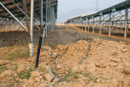 protection of land: The underground electrical cable in the solar farm plant with plastic bag to cover the cable