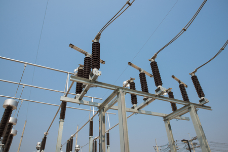 outdoor electricity: The high voltage disconnector switch in the outdoor electrical substation yard