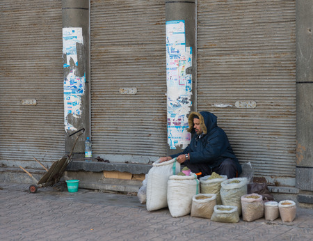 merchant: Casablanca, Morocco - March 21, 2014: The merchant prepares herb bags for sell on March 21, 2014 in Casablanca, Morocco