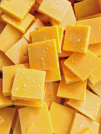 The pieces of beeswax to make candle as background Stock Photo