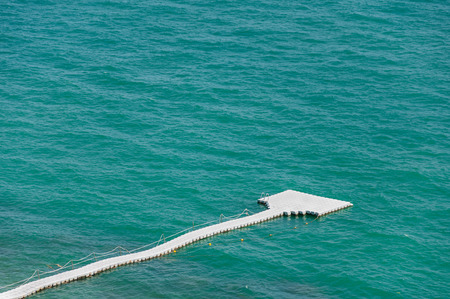 The white pontoon as walkway on the sea in Thailand as background
