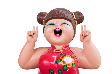 The smiling chinese girl doll in chinese dress as isolated picture