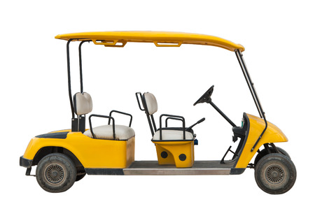 The yellow electric golf car with four seats as isolated picture Stock Photo