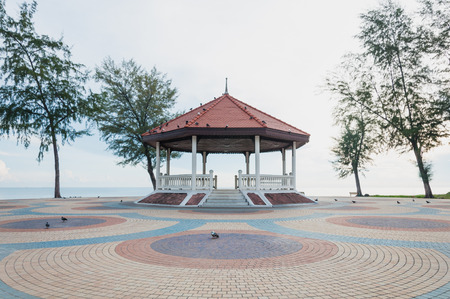 Thai pavilion on the colorful cement block near sea at Samilar beach in Songkhla, Thailand Stock Photo