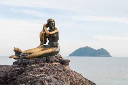 The mermaid statue on the rock at Samilar beach in Songkhla, Thailand