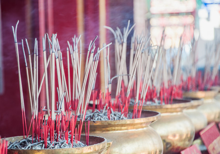 Group of joss stick in the golden pot at Chinese temple in Songkhla, Thailand Stock Photo