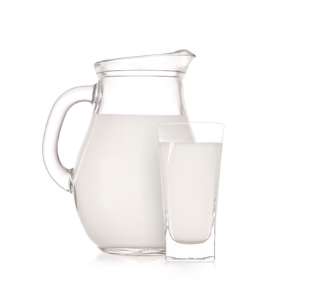 milk jug: Milk jug with glass over white background