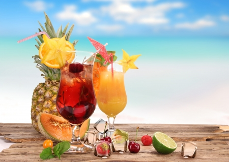 beach drink: Fruit cocktails on the beach  Stock Photo
