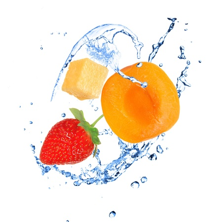 Fruit with water splash over white  photo