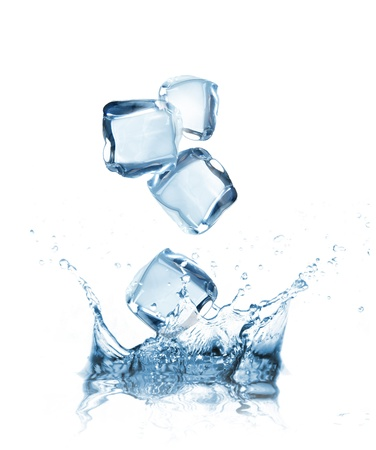 ice water: Ice cubes splashing into water over white