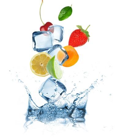 Fruit splashing into water  photo