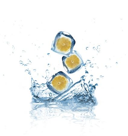 Lemons in ice cubes splashing into water  photo