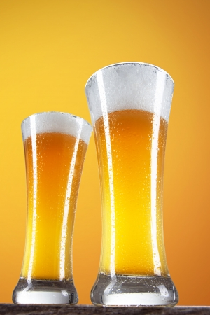 Beer in a glasses with gold background  photo