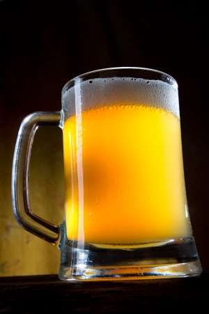 Beer in a glass with dark background  photo