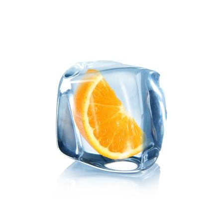 Orange slice in Ice cube over white  photo