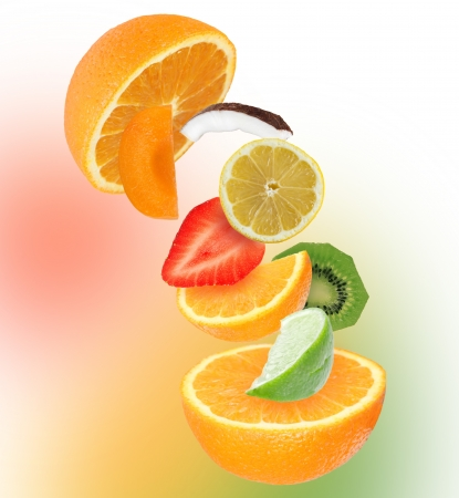 Sliced mixed fruit in motion.  photo