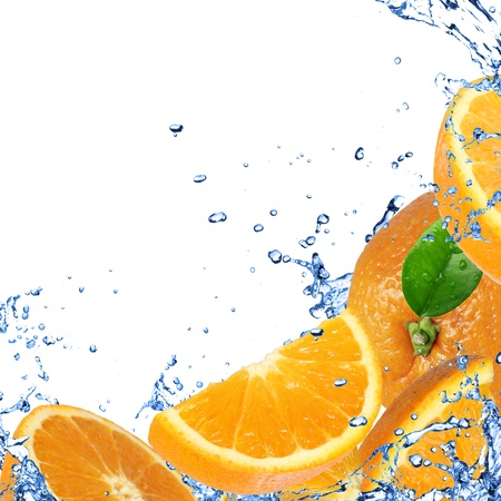 Fresh oranges background with splashing water  photo
