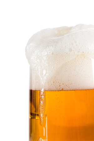 Glass of beer close-up with froth  photo