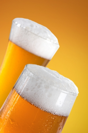 Glasses of beer close-up with froth  photo