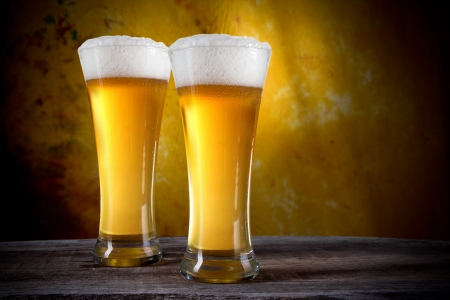 Beer in glasses with gold background Stock Photo - 14563543