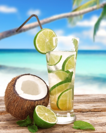 lime: Mojito cocktail on the beach