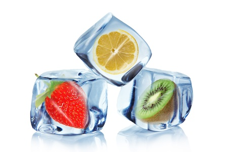 Fruit in Ice cubes over white photo