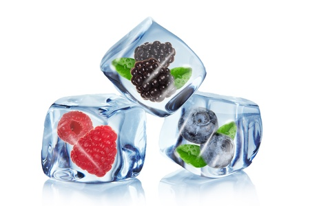 frozen fruit: Berries in Ice cubes over white
