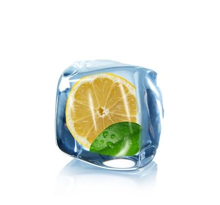 Lemon slice in Ice cube over white  photo