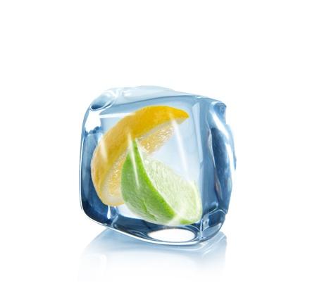lemon water: Lemon and lime slice in Ice cube over white