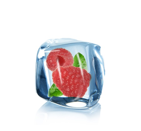 Raspberries and lime slice in Ice cube over white  photo
