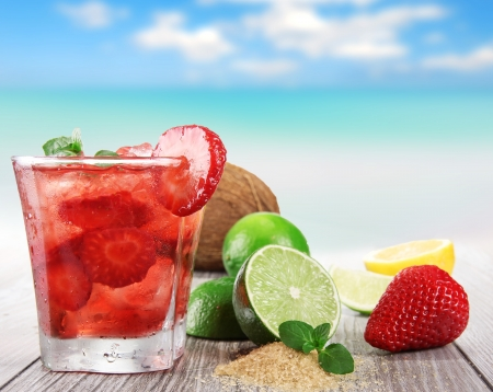 Fruit cocktail on a beach  photo