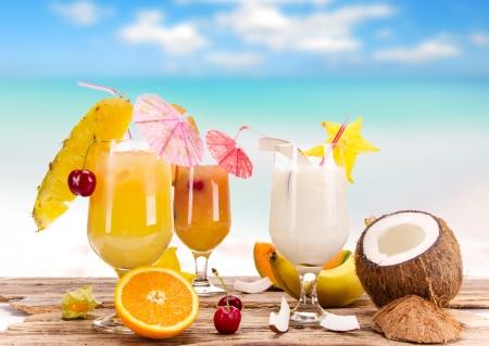Fruit cocktails on a beach  photo