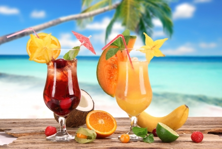 Fruit cocktails on a beach