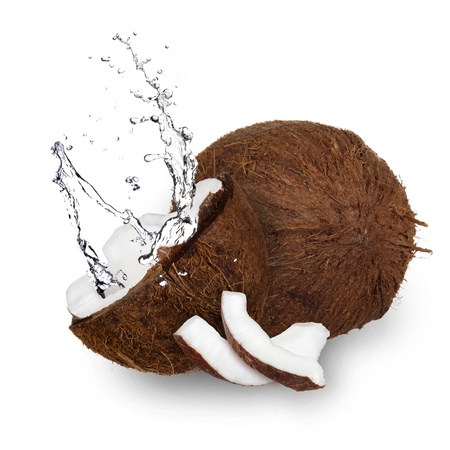 copra: Coconut with water splash over white  Stock Photo