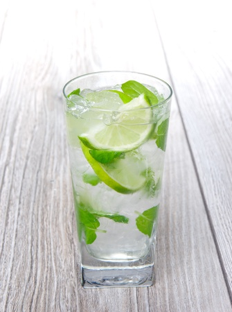 Mojito cocktail on wooden background photo