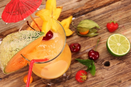Fruit cocktail on wooden background photo