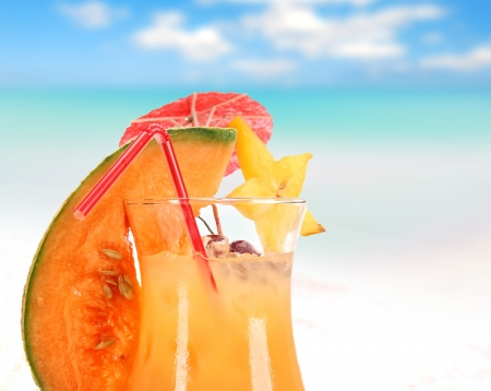 Fruit cocktail on the beach  photo