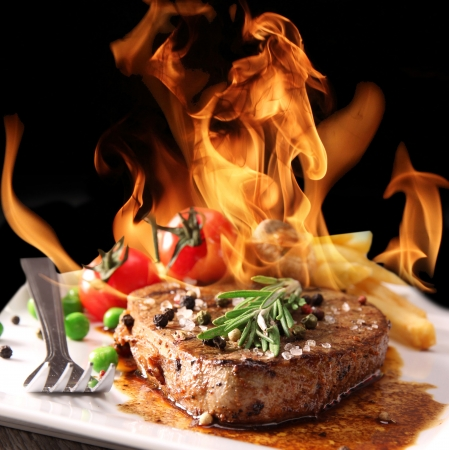steak dinner: Grilled Beef Steak with flames