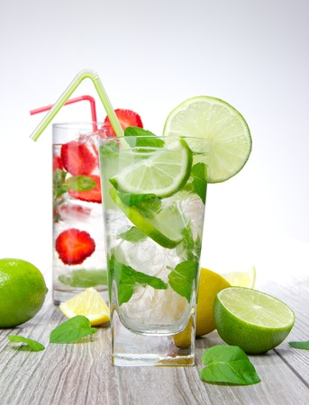 Mojito drink on wooden background  photo