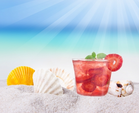 Fruit cocktail on a beach photo